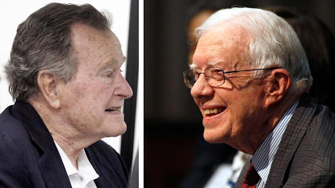 Former President George H.W. Bush, left,is seen in this Thursday, March 27, 2014. file photo taken in College Station, Texas and ormer U.S. President Jimmy Carter is seen in a June 28, 2013 file photo taken in Atlanta Georgia. Bush celebrates his 90th birthday Thursday June 12, 2014. Carter is 89 years, 254 days. (AP Photo/FILE)