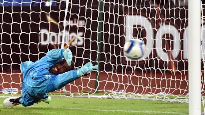 Ivory Coast's goalkeeper Boubacar Barry dives to stops Ghana's last penalty during the shout out of the Africa Cup of Nations final match in Bata on Febuary 8, 2015