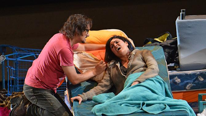 In this picture taken July 28, 2012, Piotr Beczala as Rodolfo the poet and Anna Netrebko as Mimi perform during rehearsals for the opera 'La Boheme' by Italian composer Giacomo Puccini in Salzburg, Austria as part of the Salzburg Opera Festival. (AP Photo/dapd/Kerstin Joensson)