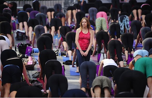 Participants take part in a mass yoga class to mark the summer solstice on Times Square in New York, June 20, 2012
