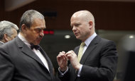 British Foreign Minister William Hague, right, speaks with Czech Republic&#39;s Foreign Minister Karel Schwarzenberg during a meeting of EU foreign ministers at the EU Council building in Brussels on Monday, Jan. 23, 2012. EU foreign ministers are set to impose an embargo on Iranian oil to pressure the country to resume talks on its nuclear program. (AP Photo/Virginia Mayo)