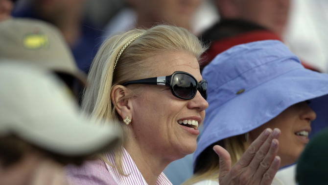 IBM CEO Virginia Rometty applauds while watching the fourth round of the Masters golf tournament from the gallery on the 18th green Sunday, April 8, 2012, in Augusta, Ga. (AP Photo/Chris O'Meara)