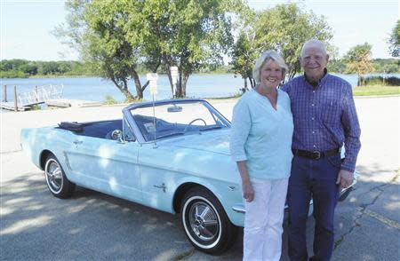 Gail and Tom Wise pose with her Skylight Blue 1964 1/2 Ford Mustang convertible in Chicago, Illinois