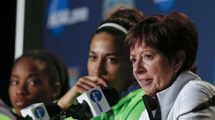 Notre Dame head coach Muffet McGraw, right, answers questions during a news conference at the NCAA women's Final Four college basketball tournament Monday, April 7, 2014, in Nashville, Tenn. Notre Dame is scheduled to face Connecticut in the championship game Tuesday. (AP Photo/John Bazemore)