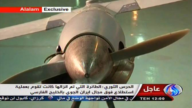 """In this image taken from the Iranian state TV's Arabic-language channel Al-Alam, showed what they purport to be an intact ScanEagle drone aircraft put on display, as an exclusive broadcast Tuesday Dec. 4, 2012, showing what they say are the first pictures of the captured drone.  Iran authorities claimed Tuesday it had captured a U.S. drone after it entered Iranian airspace over the Persian Gulf,  and showing an image of a purportedly downed craft on state TV,  but the U.S. Navy said all its unmanned aircraft in the region were """"fully accounted for.""""(AP Photo / Al-Alam TV)  TV OUT"""