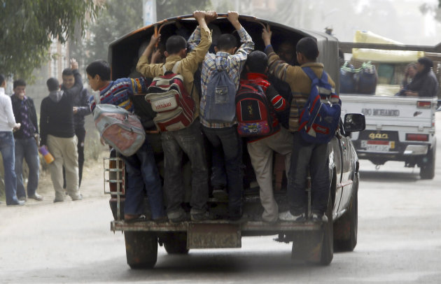 Students travel in a vehicle after attending school at Ibsheway el-Malaq village in Gharbia governorate