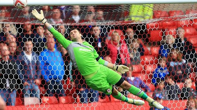 Cardiff City's David Marshall dives in vain as Nottingham Forest's Andy Reid scores past him for the first goal