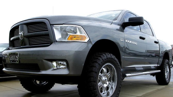 FILE- In this Sunday, June 24, 2012, file photo a new Dodge RAM 1500 pickup truck is for sale at an auto dealership in Springfield, Ill.  Auto companies are betting on a surge in pickup sales now that home building is on the rise. Chrysler said Thursday, Nov. 15, 2012, it is adding 1,000 workers to its Ram pickup factory because it sees higher demand for the redesigned truck. Ford and General Motors also say truck sales are climbing fast after several years of small but steady growth. (AP Photo/Seth Perlman, File)