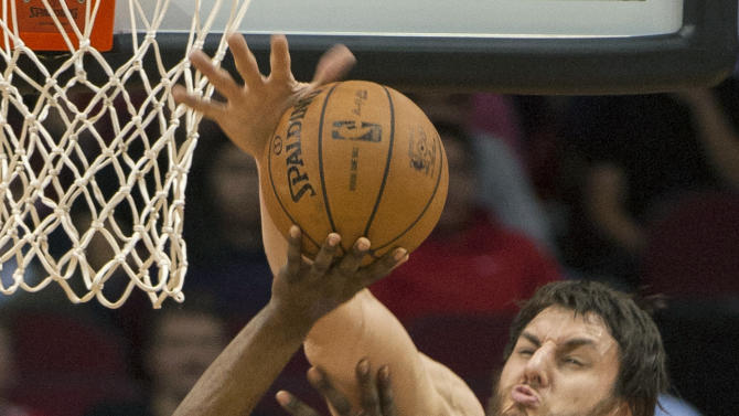 Golden State Warriors' Andrew Bogut, right, blocks a shot by Houston Rockets' James Harden (13) during the first quarter of an NBA basketball game, Tuesday, Feb. 5, 2013, in Houston. (AP Photo/Dave Einsel)