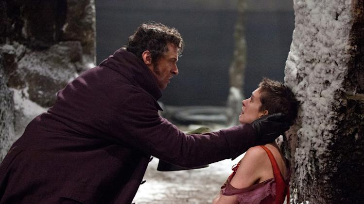 LES MISERABLES, from left: Hugh Jackman, Anne Hathaway