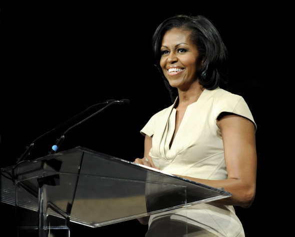 "FILE - In this June 23, 2012 file photo, first lady Michelle Obama gives the keynote address to the African Methodist Episcopal Church general conference in Nashville, Tenn. There are conflicting reports about threatening comments a police officer may have made about first lady Michelle Obama, the District of Columbia police chief said Friday, July 13, 2012. The department and the Secret Service are investigating an allegation of what it says were ""inappropriate comments"" about the first lady, allegedly made this week by a city officer who worked as a member of a motor escort for the White House. (AP Photo/Donn Jones)"