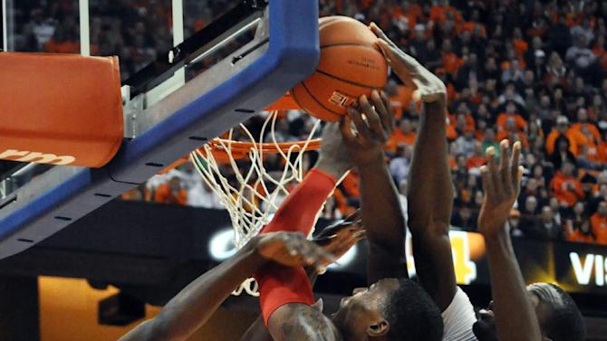 Syracuse's Jerami Grant, left, and Baye Moussa Keita, right, converge to stop Rutgers' Wally Judge from scoring during the first half of an NCAA college basketball game in Syracuse, N.Y., Wednesday, Jan. 2, 2013. (AP Photo/Kevin Rivoli)