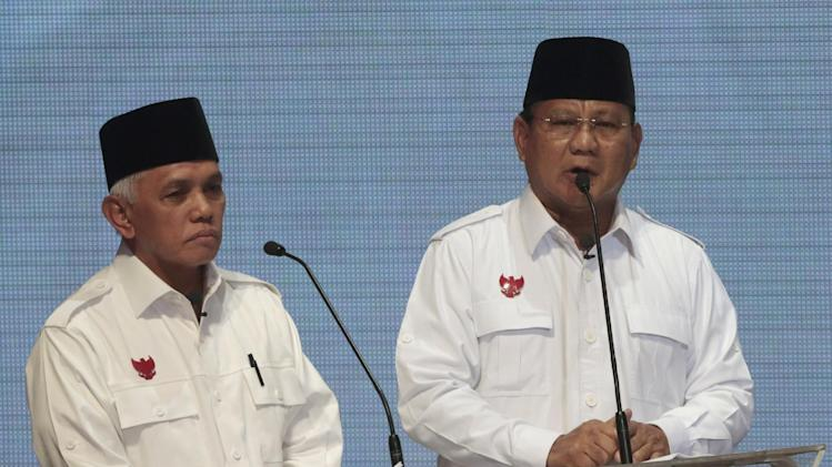 Indonesian presidential candidate Prabowo Subianto, right, delivers his speech as his running mate Hatta Rajasa listens during a televised debate in Jakarta, Indonesia, Monday, June 9, 2014. Indonesia is scheduled to hold its presidential election on July 9. (AP Photo/Dita Alangkara)
