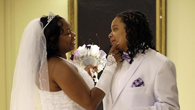 Darcia Anthony, left, and her partner, Danielle Williams, chat before participating in a marriage ceremony at City Hall in Baltimore, Tuesday, Jan. 1, 2013. Same-sex couples in Maryland are now legally permitted to marry under a new law that went into effect after midnight on Tuesday. Maryland is the first state south of the Mason-Dixon Line to approve same-sex marriage. (AP Photo/Patrick Semansky)