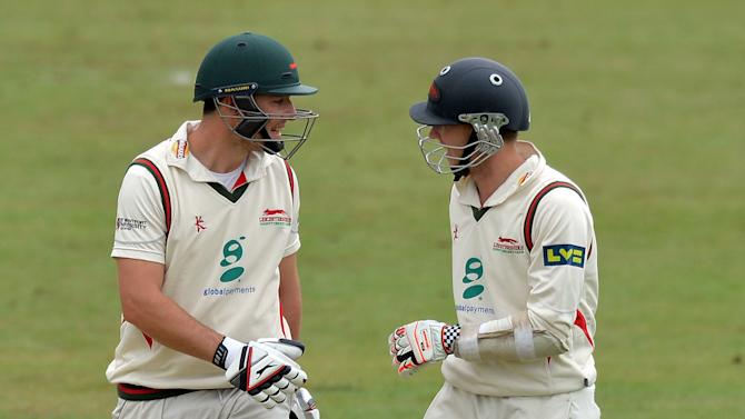 Leicestershire's Greg Smith (L) and Angus Robson talk on the third day of the cricket Tour Match between Leicestershire and India at Grace Road in Leicester, central England on June 28, 2014