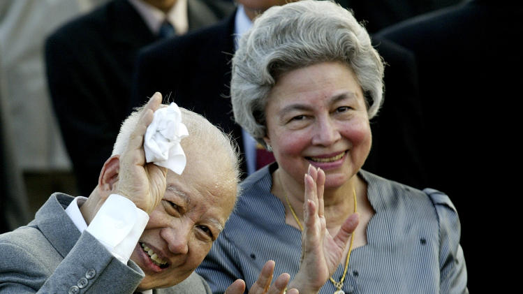 FILE - In this Oct. 20, 2004 file photo, Cambodia's King Norodom Sihanouk and Queen Monineath wave at Phnom Penh airport, in Cambodia. Sihanouk, the former Cambodian king who was never far from the center of his country's politics through a half-century of war, genocide and upheaval, died of natural causes early Monday, Oct. 15, 2012, in Beijing. He was 89.  (AP Photo/Andy Eames, File)