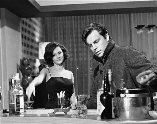 "Natalie Wood and Robert Wagner in a scene from ""All the young canibals""."