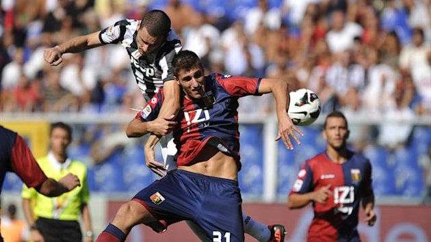 Juventus' Leonardo Bonucci (L) and Genoa's Mario Sampirisi jump for the ball (Reuters)