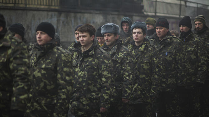 Ukrainian recruits line up as they receive military instructions from a commander in a recruitment self defense quarter at Kiev's Independence Square, Ukraine, Tuesday, March 4, 2014. Russian President Vladimir Putin ordered tens of thousands of Russian troops participating in military exercises near Ukraine's border to return to their bases as U.S. Secretary of State John Kerry was on his way to Kiev. Tensions remained high in the strategic Ukrainian peninsula of Crimea with troops loyal to Moscow fired warning shots to ward off protesting Ukrainian soldiers. (AP Photo/Emilio Morenatti)
