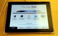 "Apple's new iPad is on display at Apple's flagship store on Fifth Avenue in New York on March 16. South Korea's Samsung won a patent battle Monday against US rival Apple, with a British judge ruling that Samsung's Galaxy tablet was not ""cool"" enough to be confused with Apple's iPad"