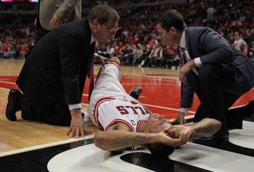 Derrick Rose of the Chicago Bulls is examined after suffering an injury