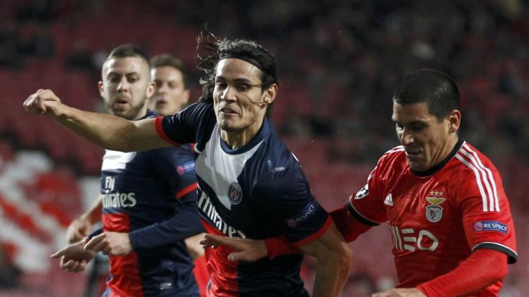 Paris St Germain's Cavani and Benfica's Pereira challenge for the ball during their Champions League soccer match in Lisbon