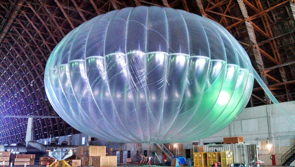In this March 1, 2013 photo released by Google, a fully inflated test balloon sits in a hangar at Moffett Field airfield, Calif. Google is testing the balloons which sail in the stratosphere and beam the Internet to Earth. (AP Photo/Google, Andrea Dunlap) EDITORIAL USE ONLY