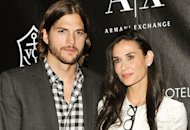 Ashton Kutcher and Demi Moore | Photo Credits: Stephen Lovekin/Getty Images