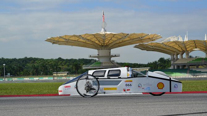 COMMERCIAL IMAGE - In this photo released by AP Images for Shell, The #66 OneDrop, Diesel Prototype, from Higher Colleges of Technology - ADMC in United Arab Emirates turns a lap on day four of the Shell Eco-marathon Challenge Asia at Sepang International Circuit in Kuala Lumpur, Saturday, July 7, 2012. Students from Asia and the Middle East have come together to compete in the four-day event. (Rener Tan/AP Images for Shell)