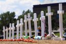 Crosses are seen at a memorial for victims behind the theater where a gunman opened fire on moviegoers in Aurora