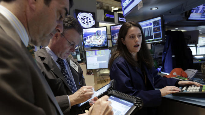 In this Friday, April 12, 2013. photo, specialist Allison Gamba works at her post on the floor of the New York Stock Exchange. Financial markets remained subdued Tuesday May 14, 2013 as investors assessed whether the recent optimism that has seen many stock indexes hit historic highs will last.(AP Photo/Richard Drew)