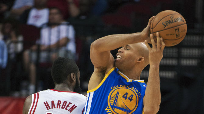 Golden State Warriors' Richard Jefferson (44) loses control of the ball as Houston Rockets' James Harden (13) defends during the third quarter of an NBA basketball game, Tuesday, Feb. 5, 2013, in Houston. The Rockets beat the Warriors 140-109. (AP Photo/Dave Einsel)