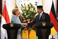 "German Chancellor Angela Merkel (L) and Indonesian President Susilo Bambang Yudhoyono give a joint press conference following bilateral talks at the presidential palace in Jakarta. Merkel signed an agreement Tuesday for wide-ranging cooperation with Indonesia, saying it would take bilateral ties ""to a higher comprehensive level"""