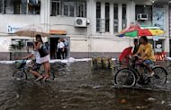 Some 50,000 people are living in evacuation centres in the Philippines after fleeing their homes following days of torrential rains caused by Tropical Storm Meari, officials said