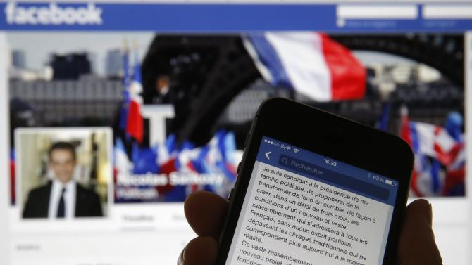 An illustration photo shows the message of former French president Sarkozy on his Facebook page opened in a mobile phone internet browser in Paris