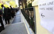 People wait in line to enter a job fair in New York April 18, 2012. REUTERS/Shannon Stapleton