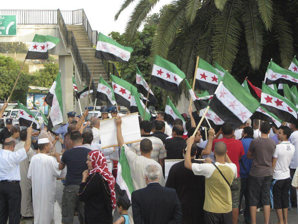 This citizen journalist image provided by Shaam News Network and taken on Tuesday, July 3, 2012, purports to show a protest against violence by the Syrian government, in a suburb of Damascus, Syria. (AP Photo/Shaam News Network) THE ASSOCIATED PRESS HAS NO WAY OF INDEPENDENTLY VERIFYING THE CONTENT, LOCATION OR DATE OF THIS PICTURE.