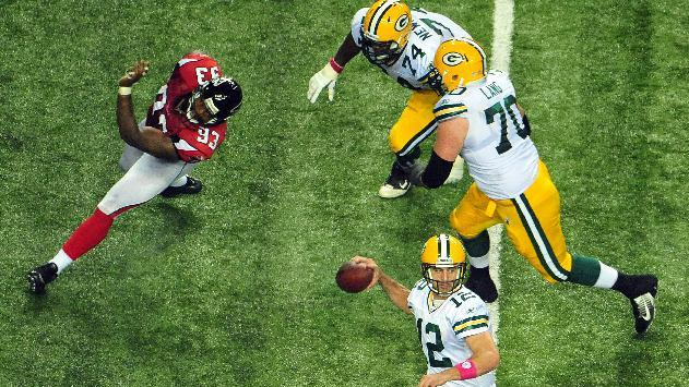 Green Bay Packers quarterback Aaron Rodgers (12) looks to pass against the Atlanta Falcons during the second half of an NFL football game, Sunday, Oct. 9, 2011, in Atlanta. (AP Photo/Pouya Dianat)