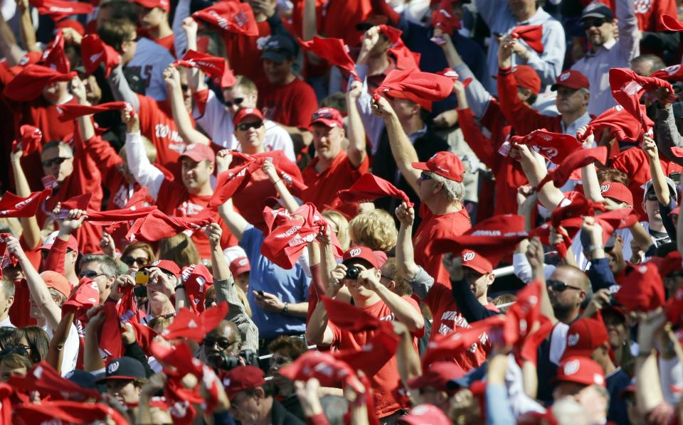 Fans wave towels and cheer before Game 3 of the National League division baseball series between the Washington Nationals and the St. Louis Cardinals on Wednesday, Oct. 10, 2012, in Washington. (AP Photo/Pablo Martinez Monsivais)