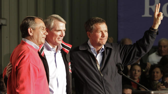 FILE - In this Nov. 1, 2010 file photo, U.S. Rep. John Boehner, left, U.S. Senate candidate Rob Portman, center, and Ohio gubernatorial candidate John Kasich come together at the end of a rally in Cincinnati. Conservatives within their own party pose challenges to the three Republican stars in the political battleground state of Ohio. Gov. Kasich has riled conservatives by embracing Medicaid expansion and some tax proposals, while House Speaker Boehner is clashing with conservative groups over the federal budget. Sen. Portman faces backlash from social conservatives over his about-face in favor of gay marriage. (AP Photo/Al Behrman, File)