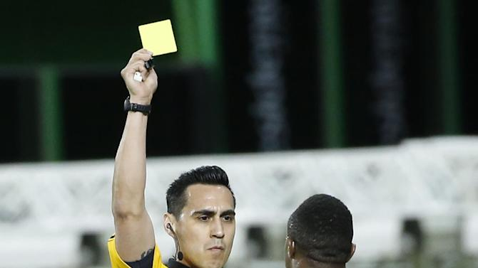 Senegal's Boubacar Cissokho receives a yellow card during the first half of a soccer match against Mexico at Marlins Park, Wednesday, Feb. 10, 2016, in Miami. (AP Photo/Wilfredo Lee)