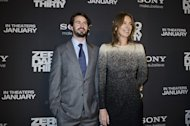 "Mark Boal (L) and Kathryn Bigelow pose for photos at the Newseum during the ""Zero Dark Thirty"" Washington DC premiere on January 8, 2013. Bigelow defended Wednesday her controversial Oscar-tipped movie ""Zero Dark Thirty"" against criticism of its depiction of torture in the hunt for Osama bin Laden"