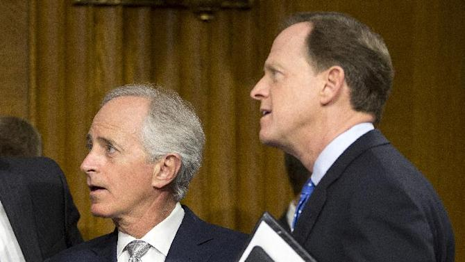 FILE - In this Feb. 26, 2013 file photo, Sen. Bob Corker, R-Tenn., left, and Sen. Pat Toomey, R-Pa., talk on Capitol Hill in Washington. Enveloped by political gridlock, President Barack Obama is reaching out to rank-and-file Republicans, hosting GOP senators for dinner at the White House Wednesday night and then visiting Capitol Hill next week for separate meetings with Senate and House Republicans.  (AP Photo/Carolyn Kaster, File)