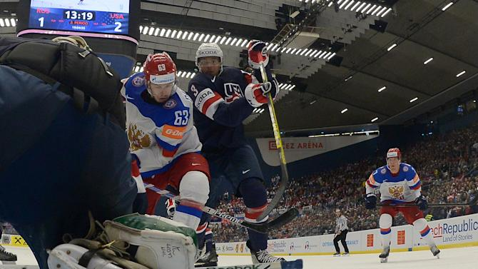 Jones of the US defends against Russia's Dadonov during their Ice Hockey World Championship game at the CEZ arena in Ostrava