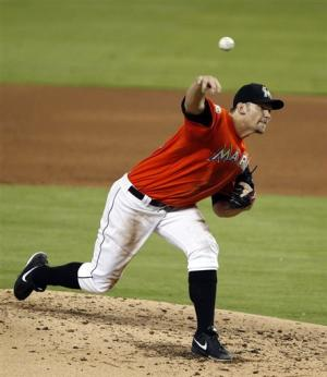 Johnson pitches 7 innings, Marlins beat Brewers