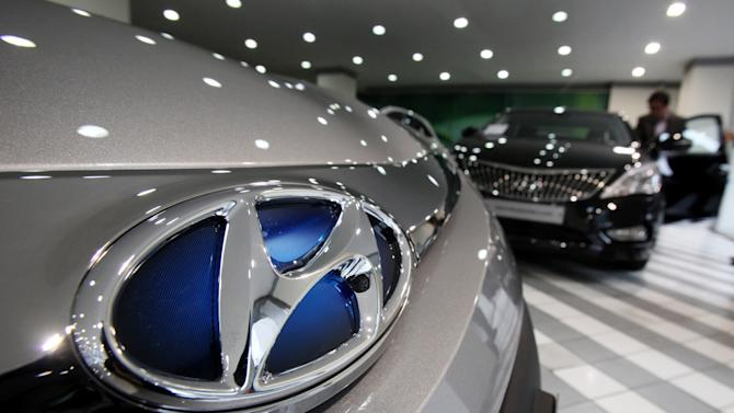 The logo of Hyundai Motor Co is seen on a car displayed at the South Korean automaker's showroom in Seoul, South Korea, Thursday, Jan. 24, 2013.   South Korea's Hyundai Motor Co. reported  its lowest quarterly profit in nearly two years due to a surge in the local currency and lackluster car sales at home. (AP Photo/Ahn Young-joon)