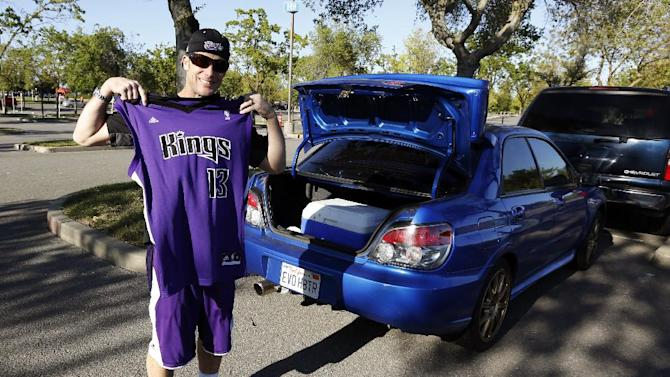 Sacramento Kings fan Dan Costa displays his replica jersey before an NBA basketball game against the Los Angeles Clippers in Sacramento, Calif., Wednesday, April 17, 2013. NBA Commissioner David Stern said Wednesday that a decision on the future home of the Kings franchise is still at least two weeks away. (AP Photo/Rich Pedroncelli)