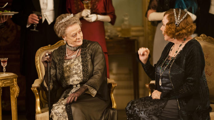 "This undated publicity photo provided by PBS shows Maggie Smith as the Dowager Countess, left, and Shirley MacLaine as Martha Levinson from the TV series, ""Downton Abbey.""   (AP Photo/PBS, Carnival Film & Television Limited 2012 for MASTERPIECE, Nick Briggs)"