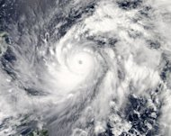 This satellite image obtained from NASA shows Typhoon Sanba on Setember 13. South Korea is bracing for the arrival of its third major typhoon in two months, with school classes cancelled, ferry routes closed and thousands of ships sheltering in port