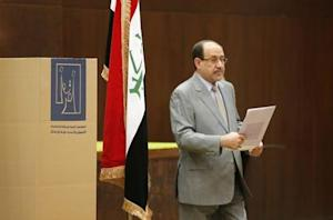 Iraq's Prime Minister Nuri al-Maliki prepares to vote during parliamentary election in Baghdad